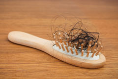 Fallen hair on the comb. The concept of hair loss Royalty Free Stock Photography