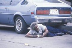 Fallen homeless man laying on city street, Los Angeles, California Stock Photo
