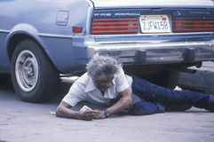Fallen homeless man laying on city street, Los Angeles, California Royalty Free Stock Images