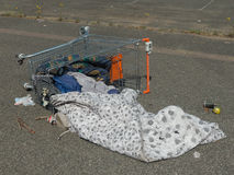 Fallen homeless supermarket trolley Royalty Free Stock Photography