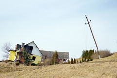 Fallen house after natural disaster - landslip. Fallen house and infrastructure after natural disaster as landslide Stock Photo