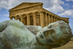 Fallen ikaro in front of concorde temple sicily Royalty Free Stock Image