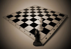 Fallen king on chess board Stock Photography