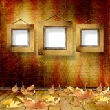 The fallen leaves on the background wall Royalty Free Stock Photo