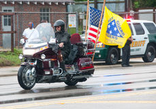 Fallen Marine Returns Home. PENSACOLA - AUGUST 24:  Patriot Guard Riders escort the fallen body of 19 year old US Marine Lance Cpl Travis Nelson as he is Stock Images