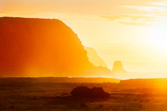 Fallen moai in golden haze in Easter Island Stock Photo
