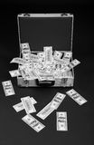 Fallen money from full suitcase Stock Images