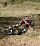 Fallen motocross racer. Royalty Free Stock Photos