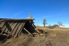 A collapsed barn on abandoned farm. Royalty Free Stock Photo