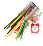 Fallen pencil cup with crayons and alarm clock Royalty Free Stock Photos