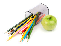 Fallen pencil cup with crayons and green  apple Stock Photography