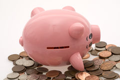 Fallen Piggy Bank and Coins Stock Photography