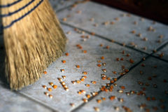 Fallen Popcorn. Sweeping up a popcorn mess Royalty Free Stock Image