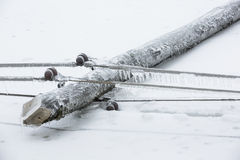 Fallen pylon covered with ice Royalty Free Stock Photography