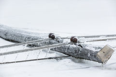 Fallen pylon covered with ice Stock Photography