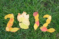 Fallen red and yellow leafs making 2012 digits Royalty Free Stock Images