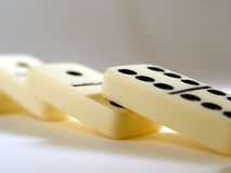Fallen Row. A row of fallen dominos royalty free stock photos
