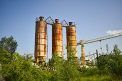 Fallen rusty industry concept photo in the abandoned cement factory with aged grunge concrete and metal strucures royalty free stock images