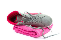 Fallen sneaker on a towel Stock Photography