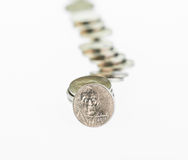 Fallen stack of US coins over white background Royalty Free Stock Photography