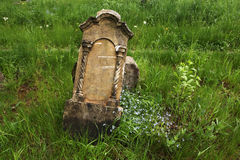 Fallen tombstone at an abandoned cemetery. Stock Photo