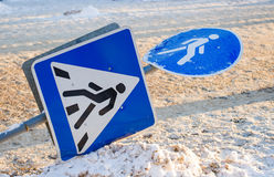 Fallen traffic sign pedestrian crossing. In the winter Royalty Free Stock Photography