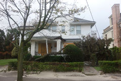 Fallen tree damaged house in the aftermath of Hurricane Sandy in Far Rockaway, New York Royalty Free Stock Photo