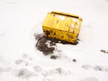Fallen turned over yellow grit box salt outside snow storm. Essex; england; uk stock images