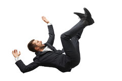Fallen und schreiender Geschäftsmann Stockfotos