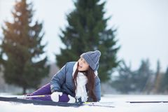 Ouch. Fallen young skier touching her hit knee and crying after accident during ski training royalty free stock images