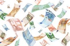 Fallende Euro auf weißem Hintergrund Lizenzfreies Stockfoto
