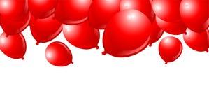 Fallende rote Ballone Stockfoto