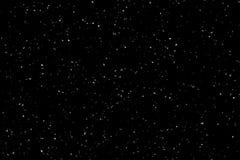 Fallender Schnee auf schwarzem Hintergrund Winterhintergrund in der reinen Dunkelheit Starke Schneefälle stockbilder