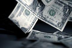 Fallendes Geld Stockbilder