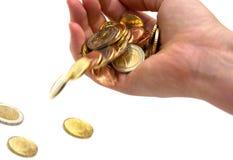 Fallendes Geld in der Hand Lizenzfreies Stockfoto
