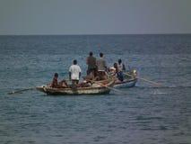 Fallenlassen des Fischernetzes Stockbilder