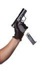 Fallenlassen eines Pistole-Klipps Stockbild