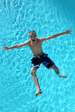 Falling. Male falling backwards into a swimming pool stock photos
