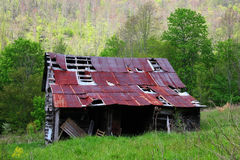 Falling Apart. An Old Barn Falling Apart Early Spring in the North Carolina Mountains royalty free stock image