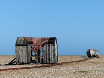 Falling apart. Relics of the former railway line, old hut and fishing boat at Dungeness, Kent Stock Photos