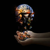 Falling apart world. The whole world falls apart but two open hands catch the pieces royalty free stock image