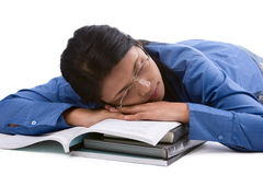 Falling asleep. A female student felt asleep after study hard Royalty Free Stock Photo