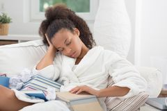 Falling asleep with a book Stock Photo