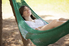 Falling asleep in a hammock Stock Photos