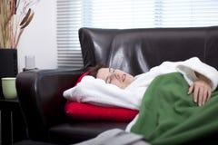 Falling asleep Watching TV stock photography