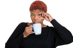 Falling asleep young woman, student holding cup off coffee stock photos