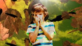 Falling autumn leaves and boy sneezing while suffering from allergy. Digital composite video of falling autumn leaves and boy sneezing while suffering from stock footage