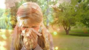 Falling autumn leaves and girl sneezing while suffering from allergy. Digital composite video of falling autumn leaves and girl sneezing while suffering from stock footage