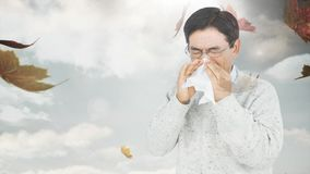 Falling autumn leaves and man sneezing while suffering from allergy. Digital composite video of falling autumn leaves and man sneezing while suffering from stock video footage