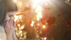 Falling autumn leaves and woman sneezing while suffering from allergy. Digital composite video of falling autumn leaves and woman sneezing while suffering from stock footage